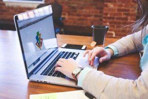 Working on Laptop | Paid Advertising-Top 5 Best Strategies | getdigitaloffice.com